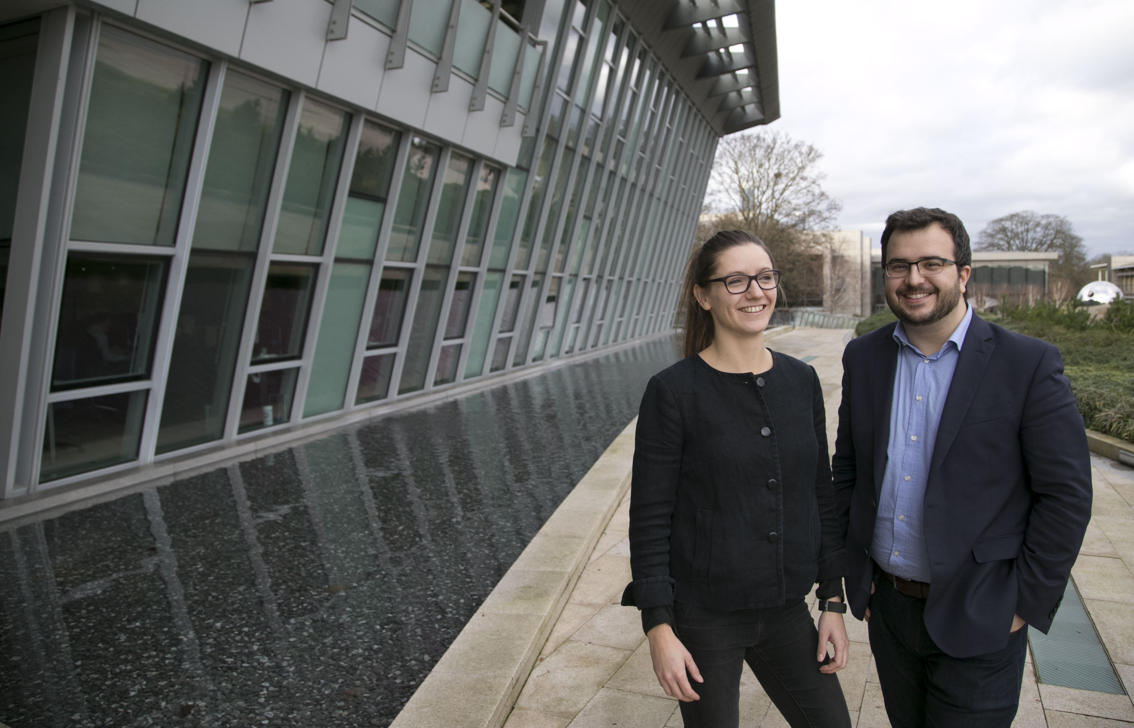 Gosia Trynka (left) and Charles Fracchia, BioBright CEO, outside of the Wellcome Sanger Institute building in Cambridge, UK